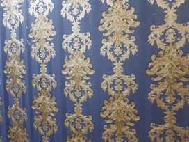 Wooden partition with 3d metallic wallpaper
