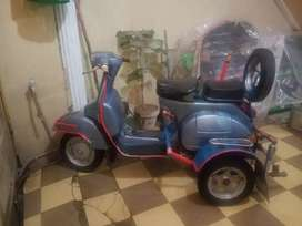 4 wheels vespa