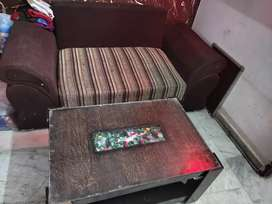 Two sitter sofa good condition with center table