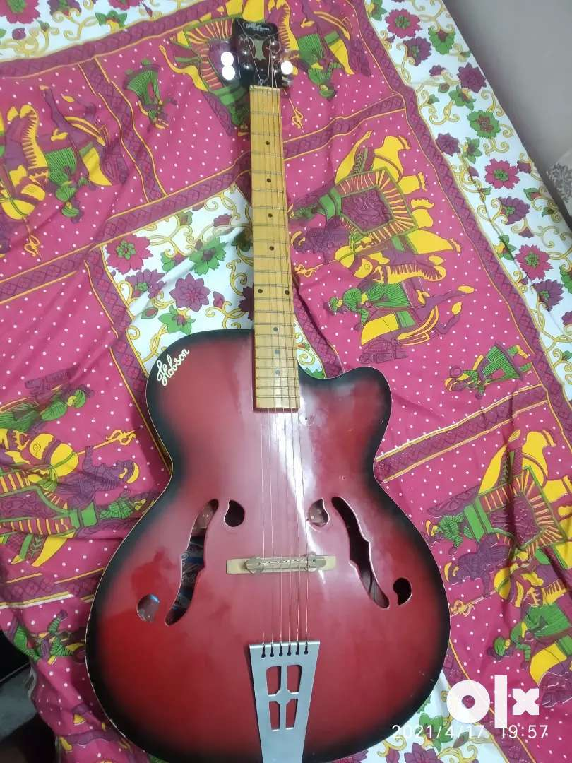 Acoustic guitar for sale, including guitar cover.