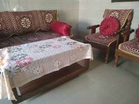 Sofa along with table and covers.