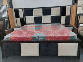 Double bed with side table at manufacturer rates