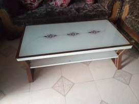 A set of 7 seater sofa and a single bed And a center table