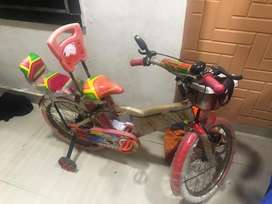Kids cycle with side wheels and double seat