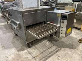 Pizza oven conveyor,deep fryers,counters,cooking range,hot plate,table