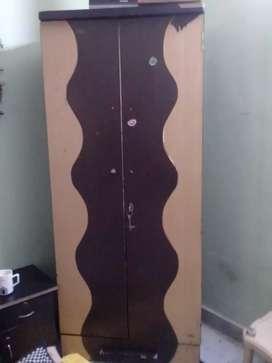 A medium wooden wardrobe for sell