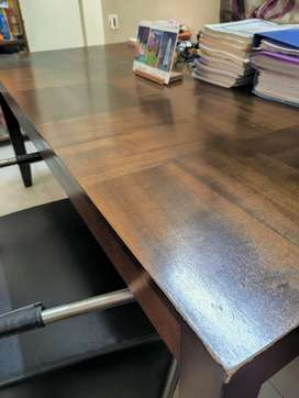 Six seater dining table in walnut finish by HomeTown