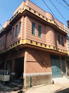 2.5marla house in which 3 shops on start rent 34000