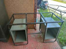 Steel table with 6 drawers.
