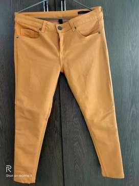 Orange color UCB jeans