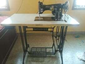 Electric merit tailor machine