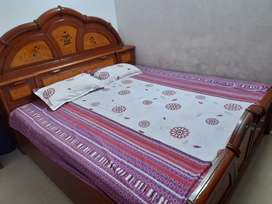 King size double bed along with a beautiful dresser
