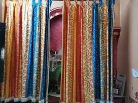 Orange coloured printed curtains. (2pair)