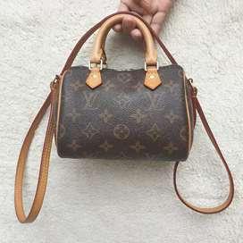Louis Vuitton Speedy mini sling bag