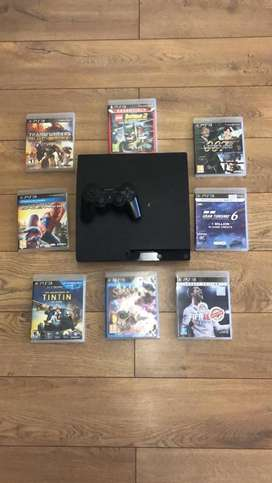 Sparingly used playstation PS3 with controller and 8 games