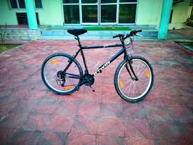 Btwin Rockrider 300 , 21 gear cycle with headlight and a tail lamp .