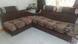 L shaped sofa with steel net at the base
