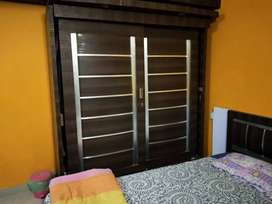Queen size bed with storage and 6ft wardrobe with sliding doors