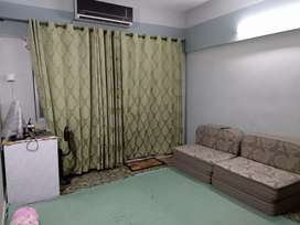 West Open and well maintained flat on main road shahrah faisal