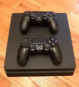 PS4 Slim 1TB. With 2 joysticks and 4 game CDs