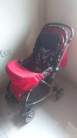 Unused baby stroller with unused baby carrier