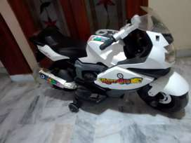 One kids battery operated bike and cycle for sale.