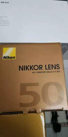 Lensa Nikon 50mm F1.8. kondisi seperti baru.