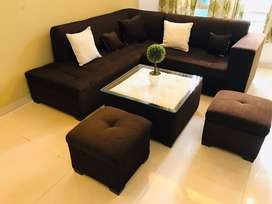 L-shaped sofa (5+2 seater) with table, cushions and pot