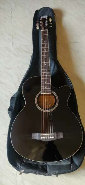 SEMI ACOUSTIC GUITAR WITH BAG AND PAIR OF picks available