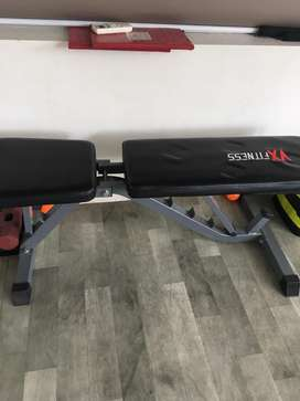 Workout bench with incline and decline facilities.