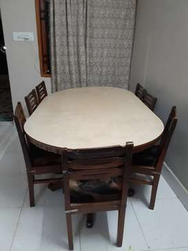SagwaanWooden dyning table with 8 wooden chairs