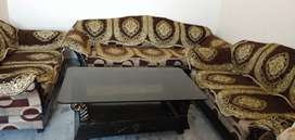 7 seater sofa with cover and glass top center table