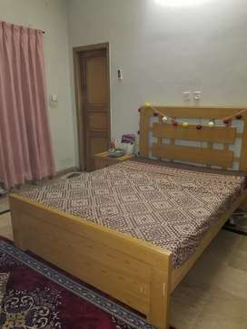 Queen size wooden bed with mattress, dressing and side table