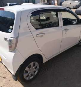 Great condition first owner well maintained car parel white colour