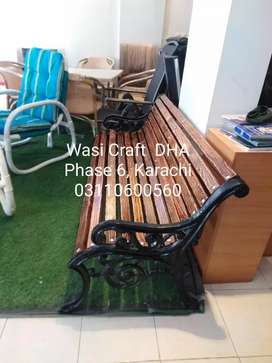 Park benches made with iron and wood