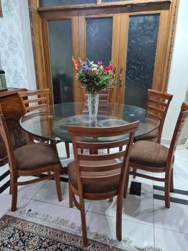 Round glass dinning table with six chairs