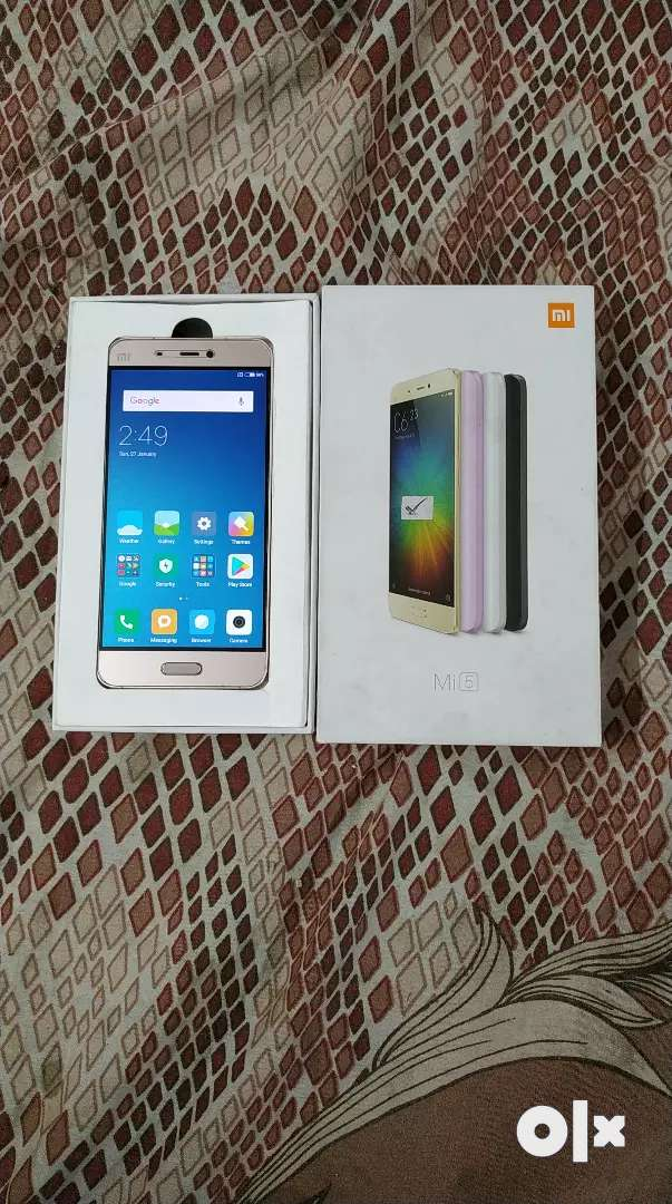 Xiomi mi 5 {GOLD} Is in very good condition 4g 0