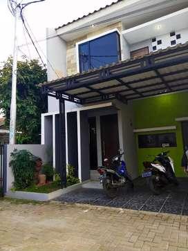 Rumah minimalis dua lantai siap huni jatimakmur