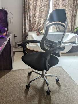 Revolving mesh Chair height and back adjustable