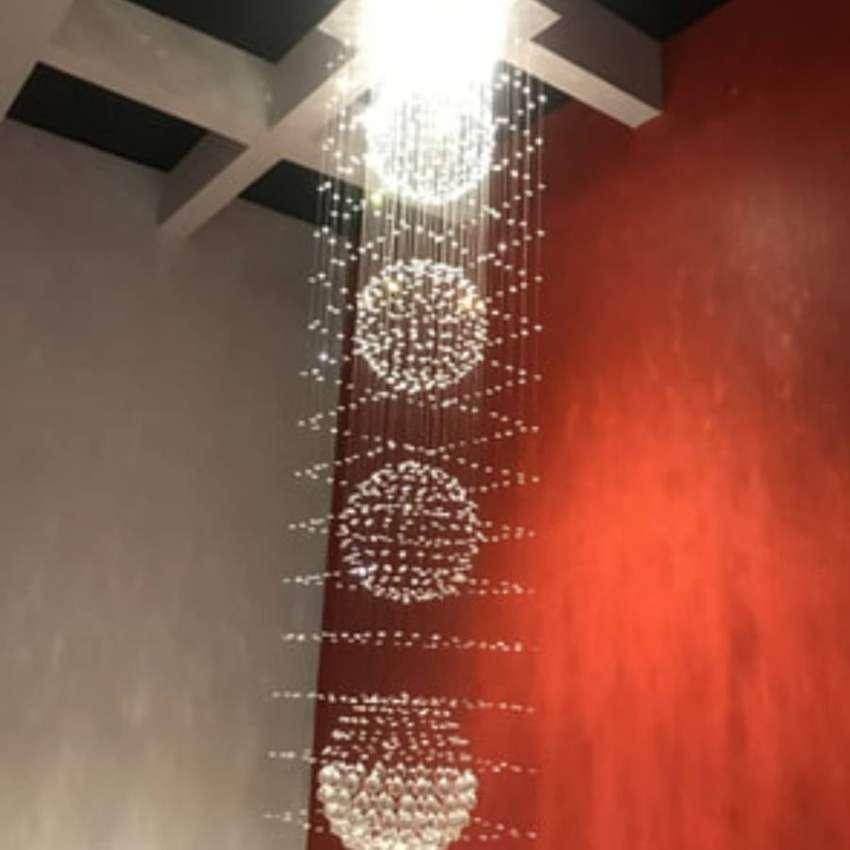 Lampu hias gantung kristal minimalis dekorasi void ruang tamu ID830