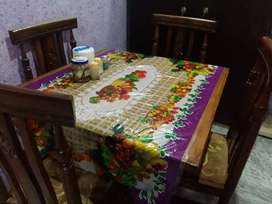 Wooden dining table with 4 chairs good condition
