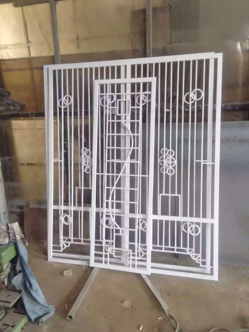 Tralis jendela besi minimalis bengkel las listrik Buana Steel