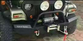 Off road bumper with winch plate