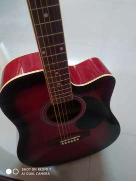 New red and black acoustic guitar.used once