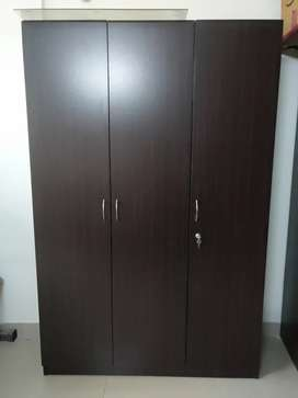 3 Door wardrobe in walnut finish by HomeTown