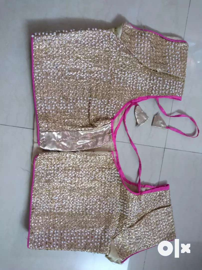 Pretty white beads blouse with pink outline goes on any saree 0