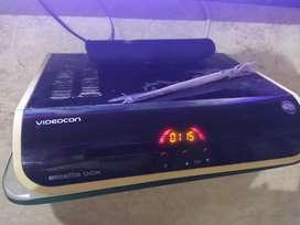 Videocon d2h set top Box, remote and dish antenna.