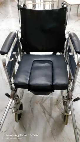 Wheel chair with removable pan.
