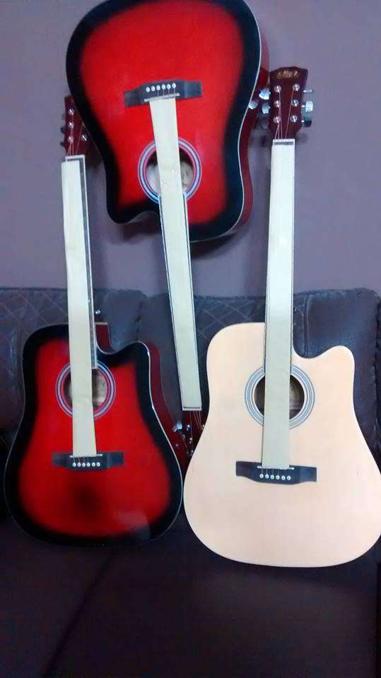 new furnished quality wood branded guitars available all new guitars 0