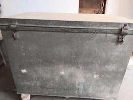 Iron peti or a big box.